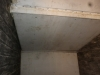raw-asbestos-board-ceiling-to-boiler-room-stairwell