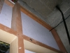 raw-asbestos-insulation-board-above-electrical-cupboard-doors