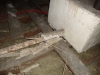 raw-and-exposed-thermal-insulation-to-pipe-lagging-and-water-tank-within-roof-space
